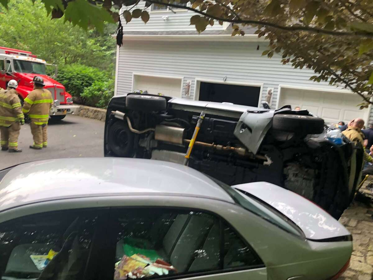 Scene of the rollover with entrapment on Jacobs Lane in Bethel, Conn., July 3, 2020.