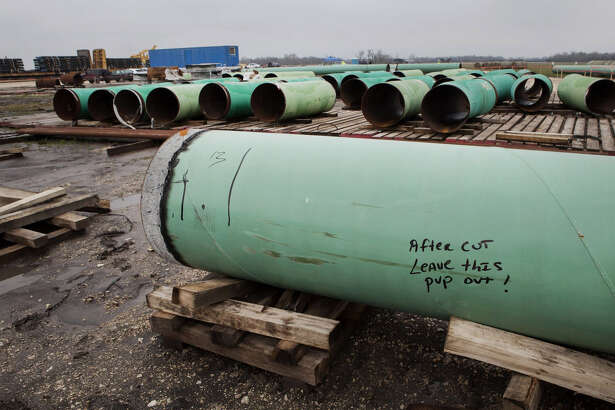 Pipes sit at the TransCanada Corp. Houston Lateral Project pipe yard in Mont Belvieu, Texas, U.S., on March 5, 2014.