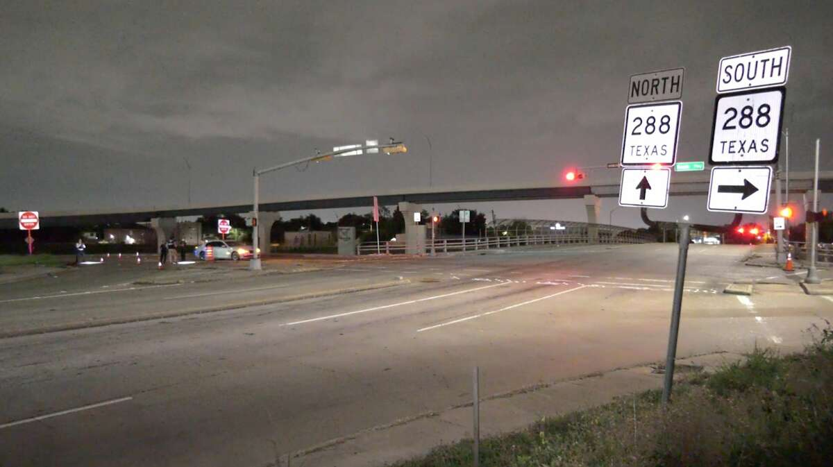 Houston police investigate a shooting that took place at the intersection of Holcombe Boulevard and the South Freeway on Sunday, July 5, 2020.