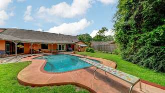 The four-bedroom, three-bath house with a pool and decidedly 1960s character is now on the market for $375,000.