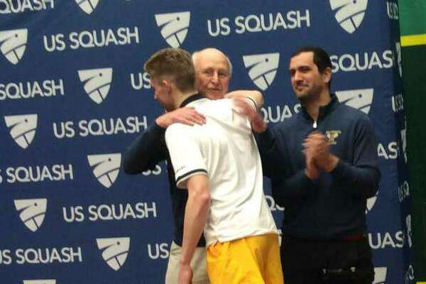 Brunswick School squash coach Jim Stephens embraces standout player Brian Leonard, after the Bruins won the Division I title at the U.S. High School Team Squash Championships in February. Stephens was recognized following the tournament for his contributions to high school squash. After teaching and coaching at Brunswick for 35 years, Stephens has retired.