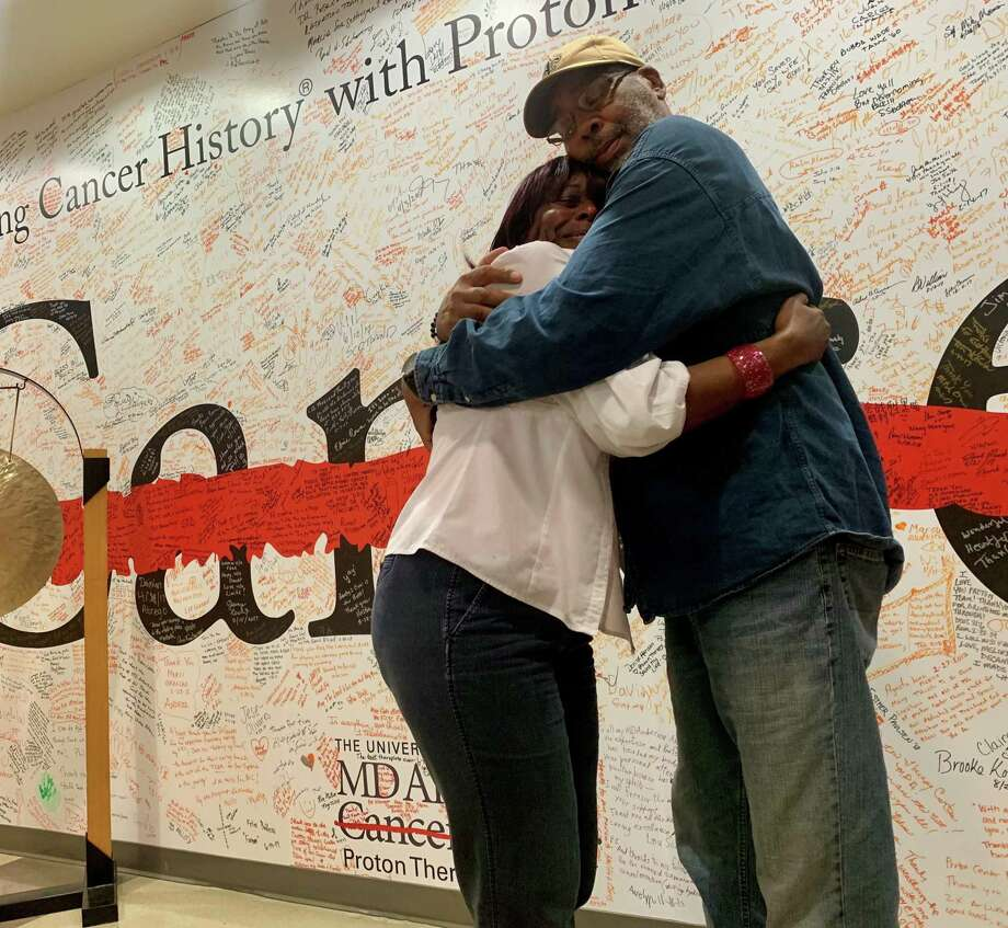Breast cancer survivor Charlene Upshaw and her husband Clarence Hollins embrace after she rings the gong celebrating the end of her proton therapy treatment at The University of Texas MD Anderson Cancer Center. Photo: Courtesy Of Charlene Upshaw