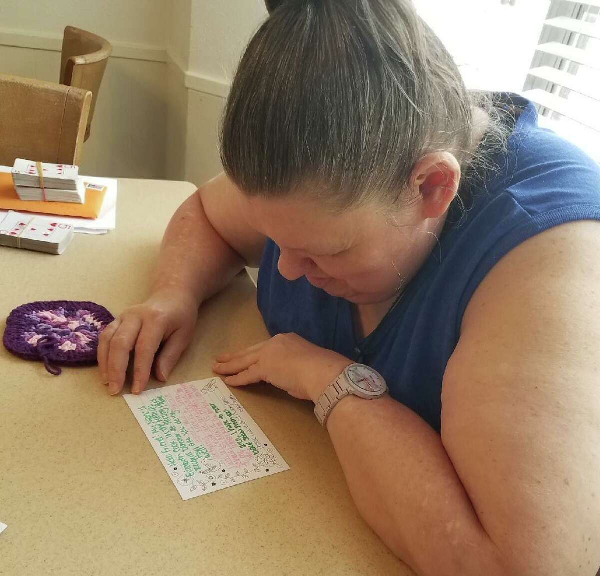 Vita Living resident Cheryl checks out her handwritten letter and crocheted piece sent from a Sterling Oaks Rehabilitation resident. The pen pal exchange began in May and has provided friendship amid the isolation of the pandemic.