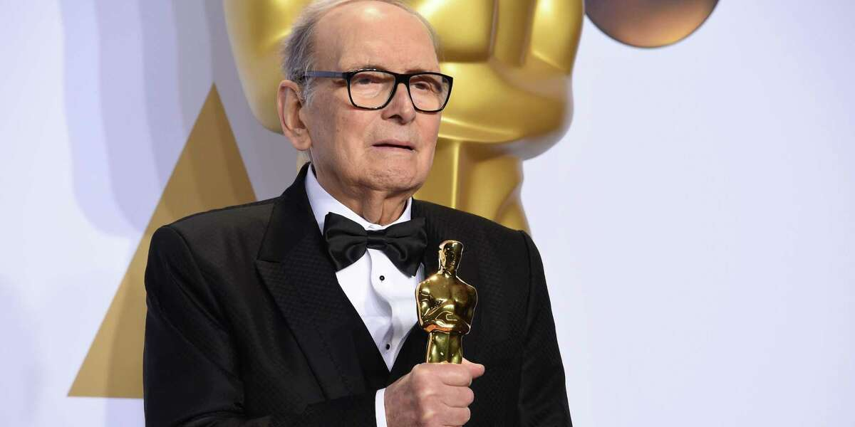 Ennio Morricone poses with his Oscar for best original score for