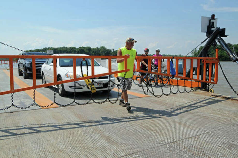 Deckhand Eddie Klunk prepares to let cars disembark the Grafton Ferry. The ferry operates Friday through Sunday, connecting passengers in Grafton and St. Charles County, Missouri.