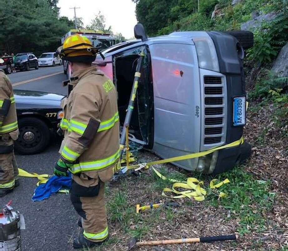 Shelton firefighters companies responded to River Road near Moulthrop Road Saturday on a report of a single-vehicle rollover with one occupant trapped. Photo: Contributed Photo / Connecticut Post