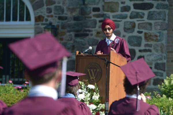 Sartaj Singh, class orator, gives his address during the Wooster School 2020 Commencement Exercises on Monday on the school campus in Danbury. Below, a grad laughs during Commencement.