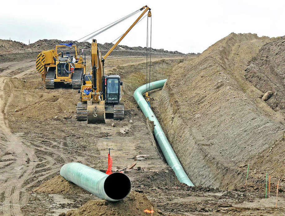Heavy equipment is used in 2016 to place sections of the Dakota Access pipeline. A federal judge Monday sided with the Standing Rock Sioux Tribe and ordered the pipeline to shut down until more environmental review is done. Photo: Tom Stromme | Bismarck Tribune (AP)