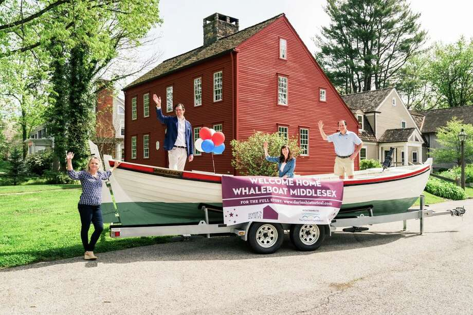 The Whaleboat Middlesex is in ship shape after a nearly 40-year odyssey, thanks to a generous grant from The Darien Foundation. Pictured from left: Maggie McIntire, executive director of the Darien Historical Society, Robert J. Pascal, Jr., president of the Darien Historical Society, Sarah Woodberry, executive director of The Darien Foundation and Ward Glassmeyer, chairman of The Darien Foundation. Photo: Katherine Calderwood