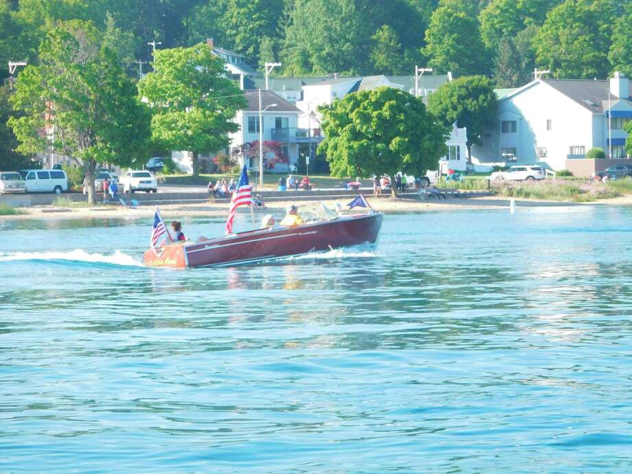 Classic Boats of Crystal Lake has held the Classic Boat Parade for 13 years, drivingChris Crafts, Centuries and Lymans around Crystal Lake on the Fourth of July. (Courtesy Photo/Vicki Carpenter)