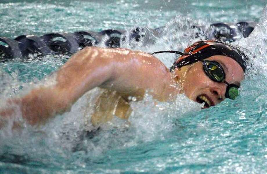 Edwardsville senior Josie Bushell is on her way to a first-place finish in the 100-yard freestyle on Nov. 23, 2019, during the Springfield High Sectional at Eisenhower Pool. Photo: Scott Marion/The Intelligencer