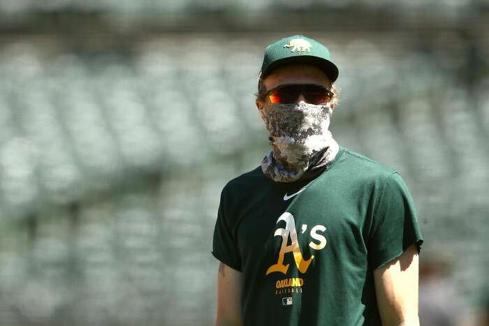 OAKLAND, CALIFORNIA - JULY 05: Jake Diekman #35 of the Oakland Athletics wears his mask during summer workouts at RingCentral Coliseum on July 05, 2020 in Oakland, California. (Photo by Ezra Shaw/Getty Images)