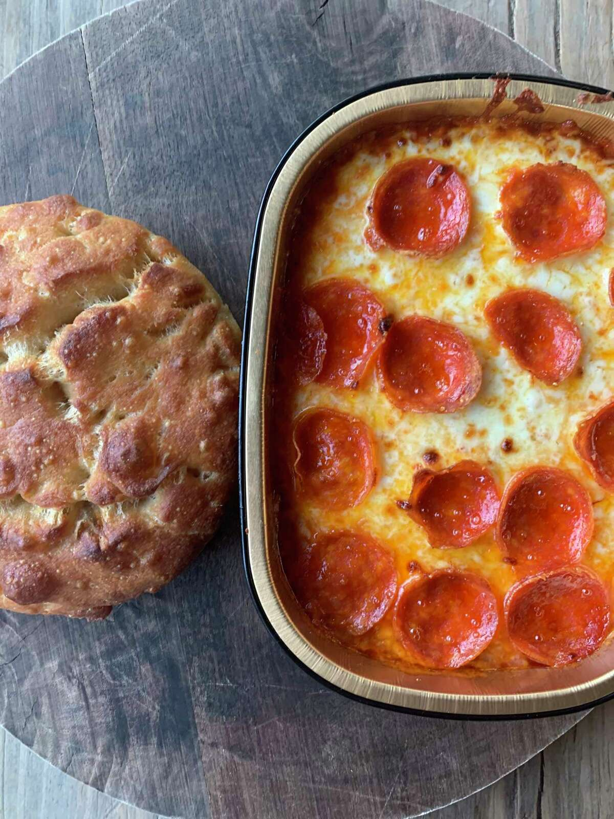 Pepperoni Pizza Dip is served with house-made focaccia at The Hay Merchant.