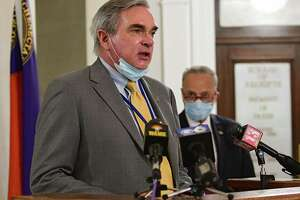 Mayor Gary McCarthy speaks as U.S. Senator Charles Schumer, right, holds a press conference in Schenectady City Hall as local governments face uncertain budgets amid crises on Monday, July 6, 2020 in Schenectady, N.Y. Mayor Gary McCarthy listens at right.(Lori Van Buren/Times Union)