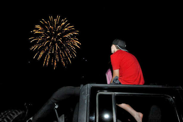 Tyler Wolff, 13, of Edwardsville watches fireworks at Edwardsville High School Friday night.