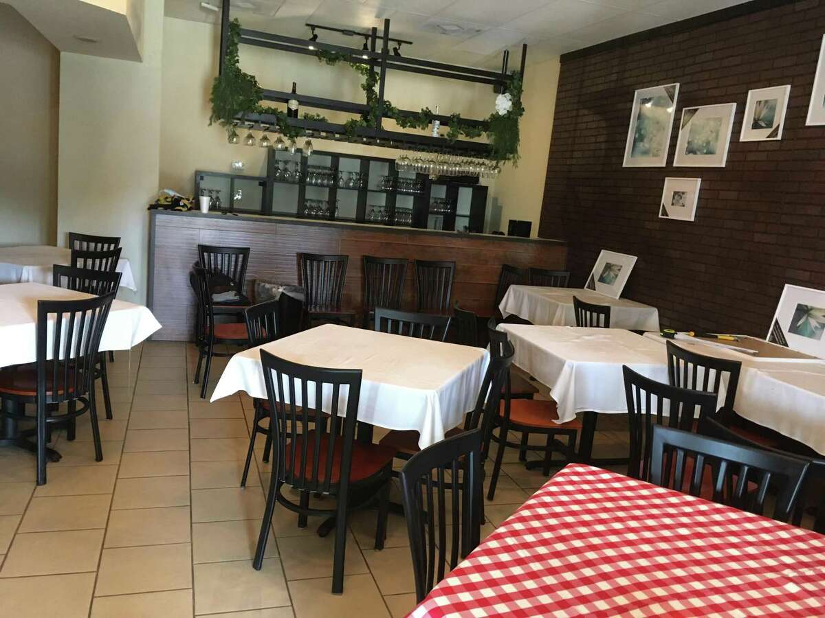 The interior dining space at La Nostra Famiglia Trattoria has room for approximately 50 customers.
