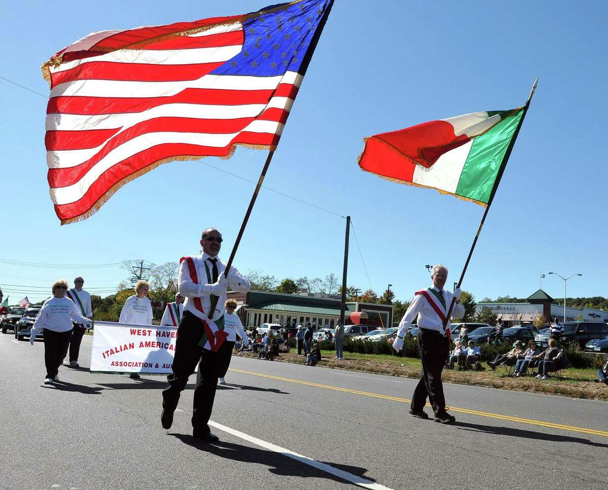 The American flag and Italian flag during the Greater New Haven Columbus Day Parade in 2010 on Dixwell Avenue in Hamden.