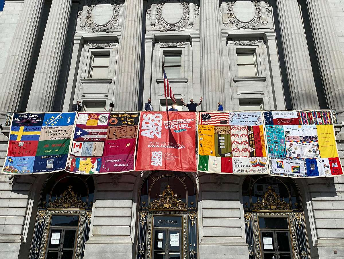 Four blocks from the AIDS Memorial Quilt hang from the San Francisco City Hall's mayor's balcony on Monday to mark the start of the virtual International AIDS Conference hosted by the Bay Area on July 6, 2020.