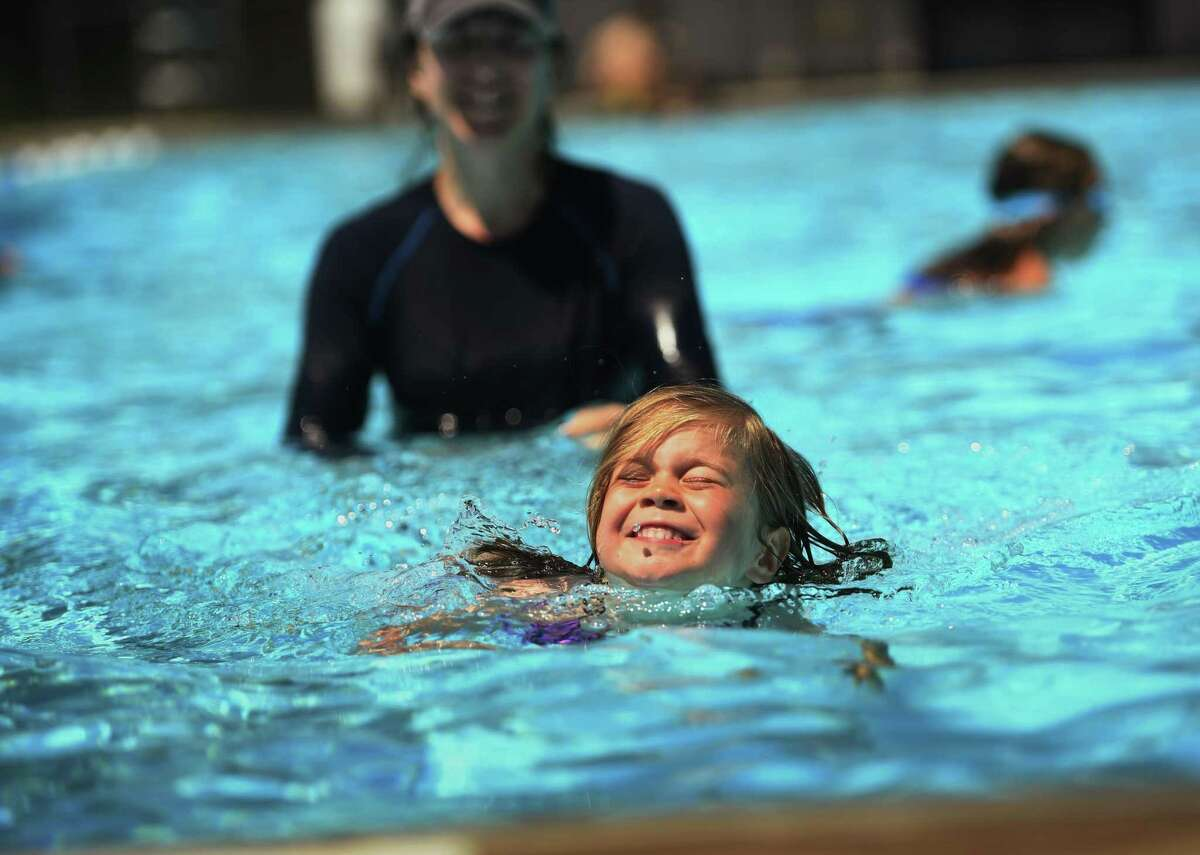 Jane Bellows, 4, of Trumbull, practices swimming under the watchful eye of her mom, Erin, during opening day at the Tashua pool in Trumbull, Conn. on Monday, July 6, 2020. Residents need to sign up for visits in advance, with a maximum of fifty visitors allowed at a time.