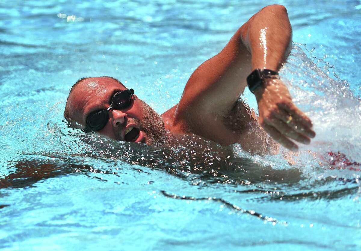 """Scott Cranston, of Trumbull, was first in line to swim laps during the opening day at the Tashua pool in Trumbull, Conn. on Monday, July 6, 2020. Cranston called the experience """"everything I expected and more"""", and added that he had been waiting for weeks for the pool to open."""