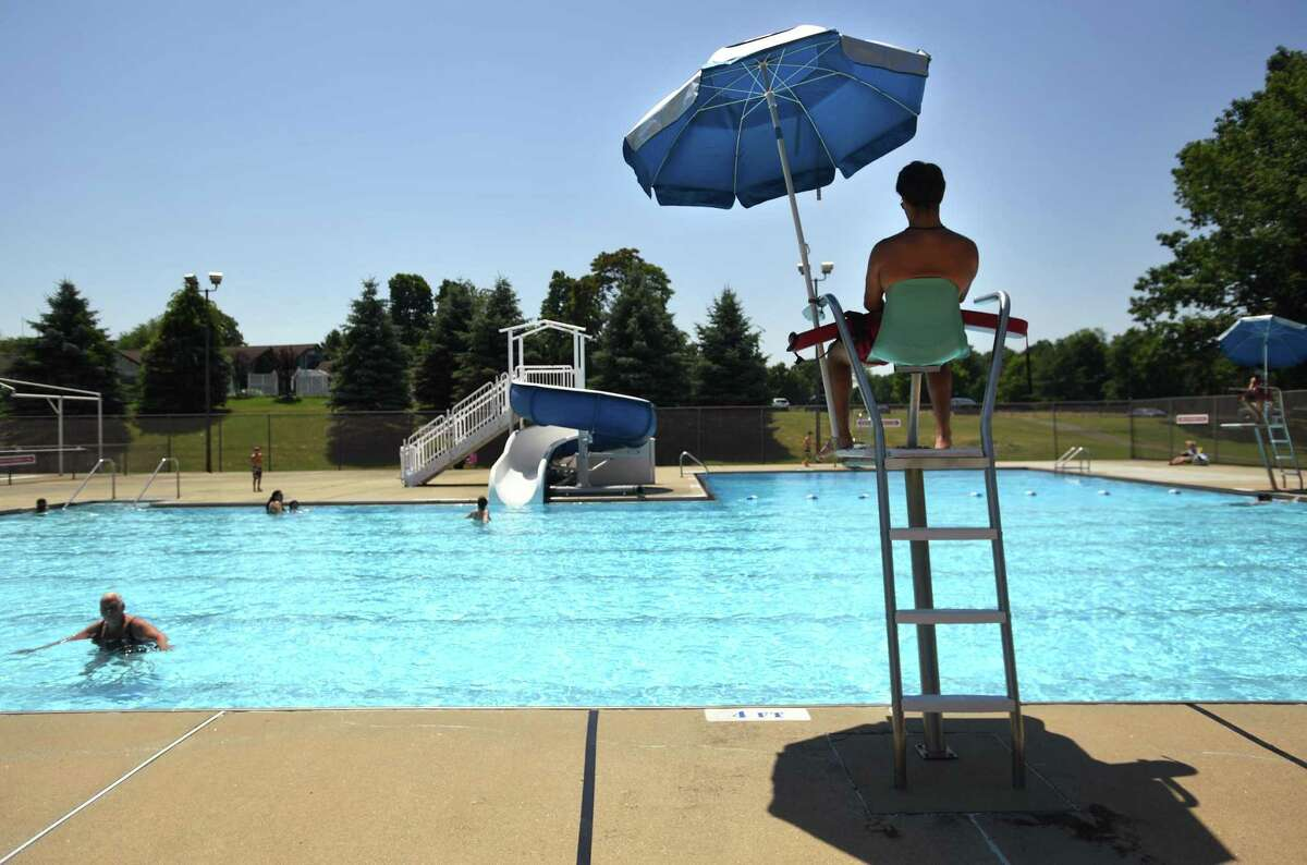 Swimmers are spaced out during opening day at the Tashua pool in Trumbull, Conn. on Monday, July 6, 2020. Residents need to sign up for visits in advance, with a maximum of fifty visitors allowed at a time.