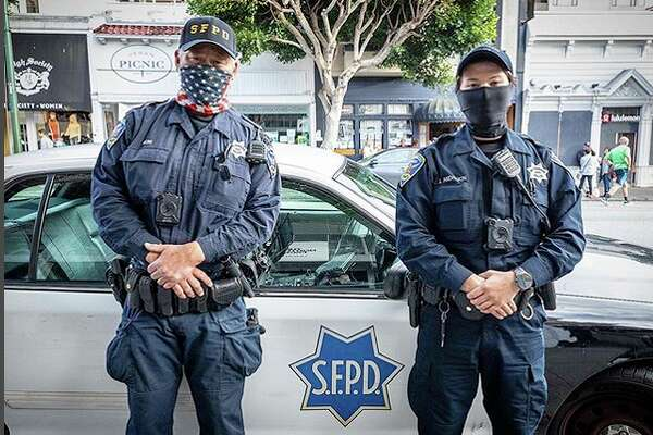 """Day #65 Quarantined in San Francisco. """"Risk Management."""" I came across these San Francisco police officers dealing with a disturbance on Union Street. They were kind enough to visit with me about the state of the city and various neighborhoods. In particular they discussed the challenges of interacting with the city's growing homeless population."""