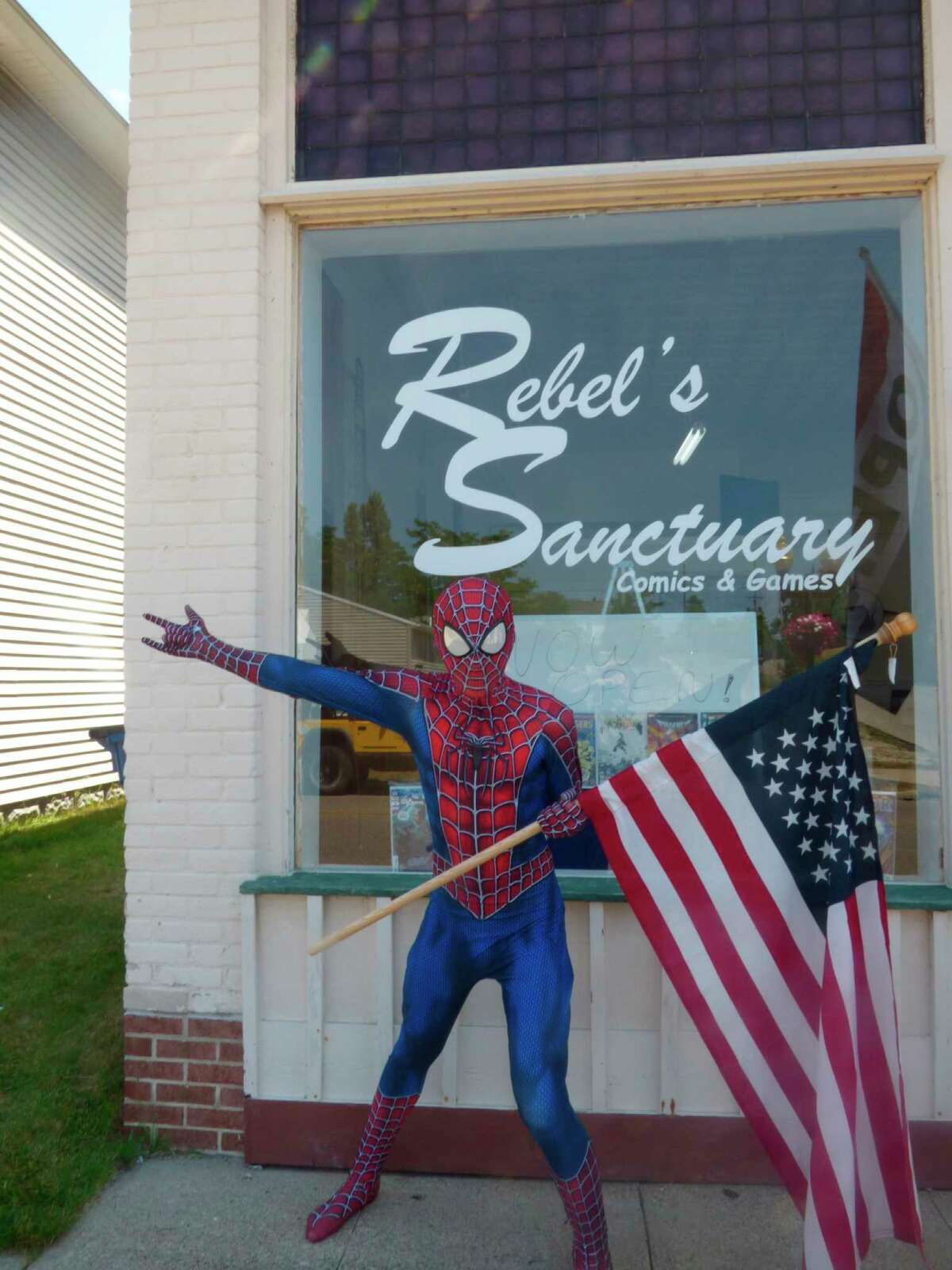 Spiderman welcomes customers over Fourth of July weekendto Rebel's Sanctuary, a new comic book shop in Manistee.(Scott Fraley/News Advocate)