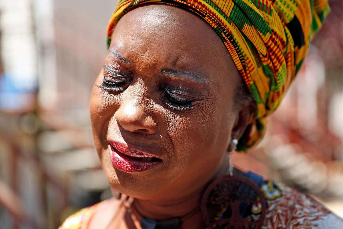 Asale-Haquekyah Chandler, the mother of Yalani Chinyamurindi, who was fatally shot in 2015, gets emotional after laying flowers and lighting a candle at the scene of the July 4th fatal shooting of 6-year-old Jace Young on Whitfield Court in San Francisco, Calif., on Monday, July 6, 2020.