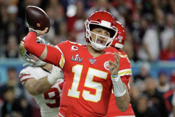 FILE - In this Feb. 2, 2020, file photo, Kansas City Chiefs quarterback Patrick Mahomes (15) passes against the San Francisco 49ers during the first half of the NFL Super Bowl 54 football game in Miami Gardens, Fla. The Chiefs have agreed to a 10-year contract extension with Super Bowl MVP Mahomes keeping him around through 2031. The Chiefs had Mahomes under contract for the next two seasons but wanted a long-term deal in place with the quarterback who led them to their first championship in 50 years. ESPN.com reported the deal is worth $450 million with an injury guarantee of $140 million.