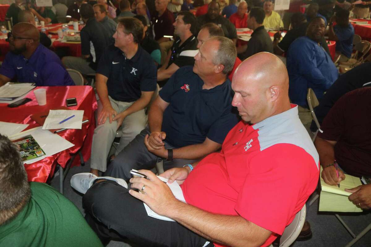 South Houston head coach Patrick Longstreet prepares to confer with another coach during last year's referee selection meeting at Phillips Field House.