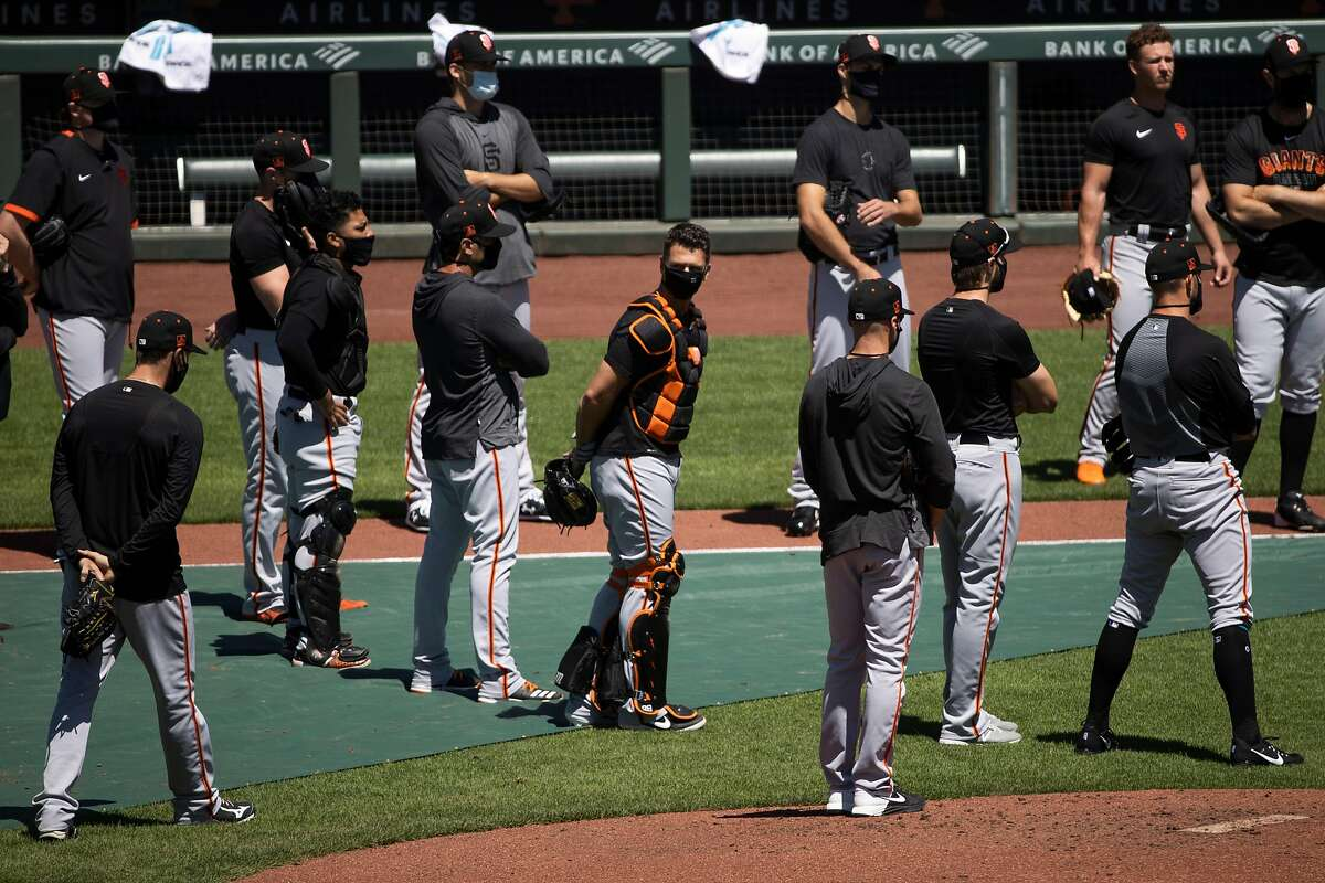 Buster Posey #28 of the San Francisco Giants, center, is seen during summer training camp at Oracle Park in San Francisco, Calif. on Monday, July 6, 2020.