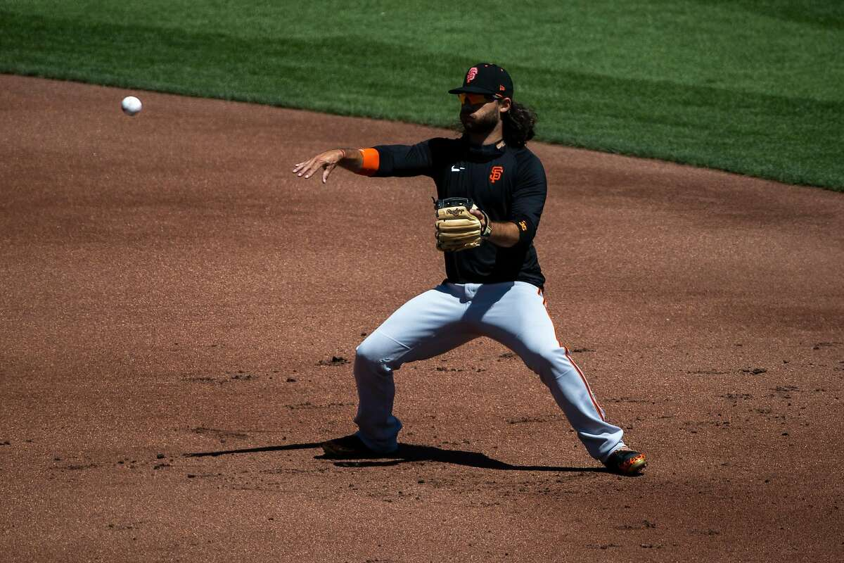 Brandon Crawford #35 of the San Francisco Giants makes a throw during summer training camp at Oracle Park in San Francisco, Calif. on Monday, July 6, 2020.