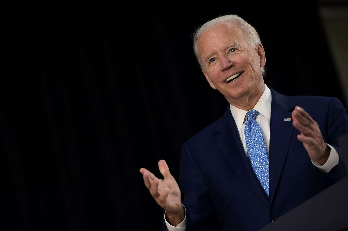 (FILES) In this file photo taken on June 30, 2020 US Democratic presidential candidate Joe Biden answers questions after speaking about the coronavirus pandemic and the economy in Wilmington, Delaware. - Democrat Joe Biden outraised President Donald Trump's re-election campaign for the second straight month and for the second quarter of 2020, figures released on July 1, 2020 showed, highlighting robust enthusiasm for the White House challenger. (Photo by Brendan Smialowski / AFP) (Photo by BRENDAN SMIALOWSKI/AFP via Getty Images)