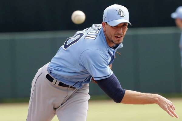 Rays starting pitcher Charlie Morton (50) warms up between innings during a spring training game.