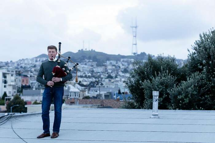 Bagpiper Hal Wilkes plays his 75 years old bagpipe on his building�s rooftop as the shelter-in-place order remains in effect to slow the spread of the coronavirus pandemic on Friday, March 27, 2020, in San Francisco, Calif.