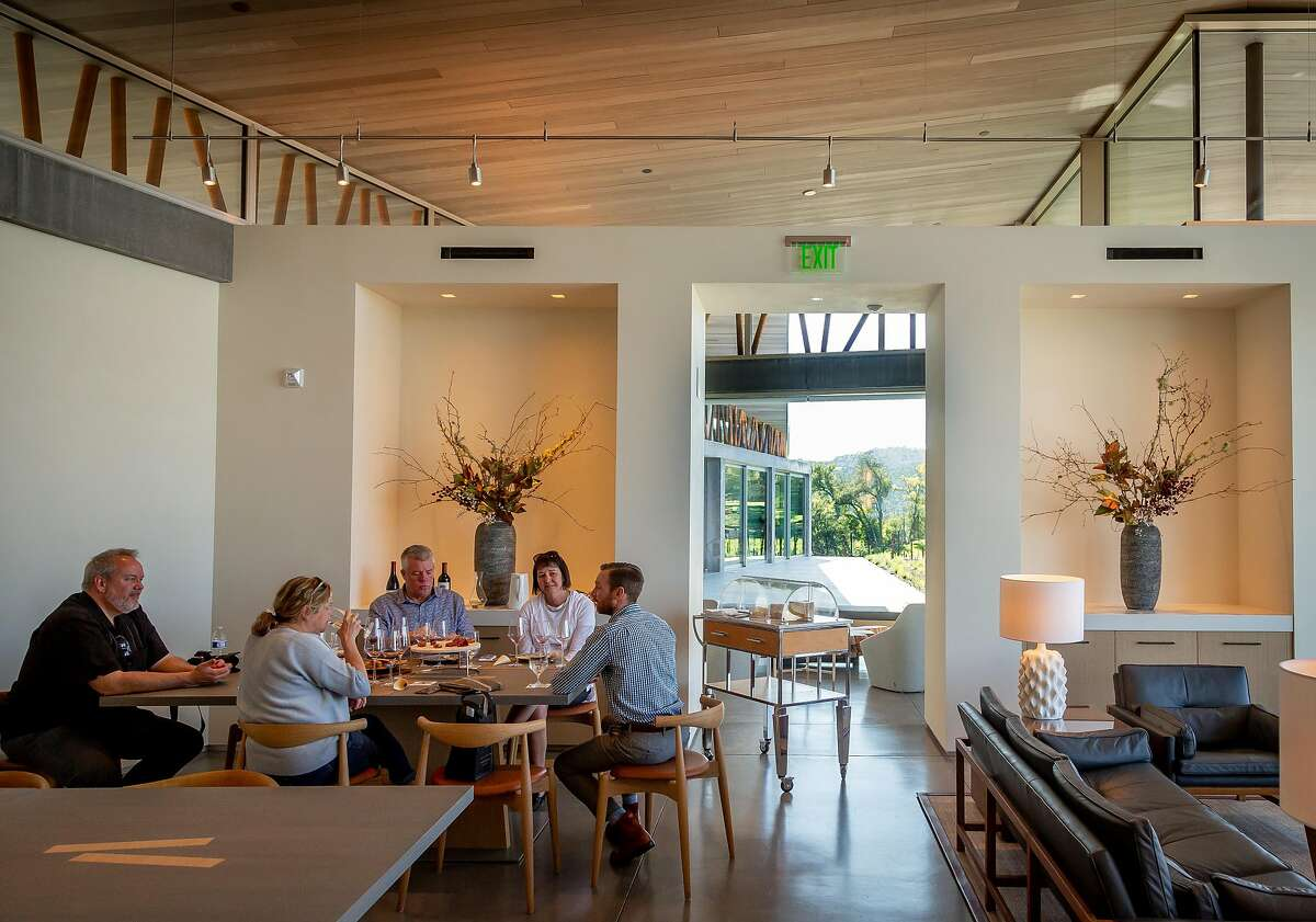 Visitors taste wine with cheese at Progeny Winery in Napa, Calif.