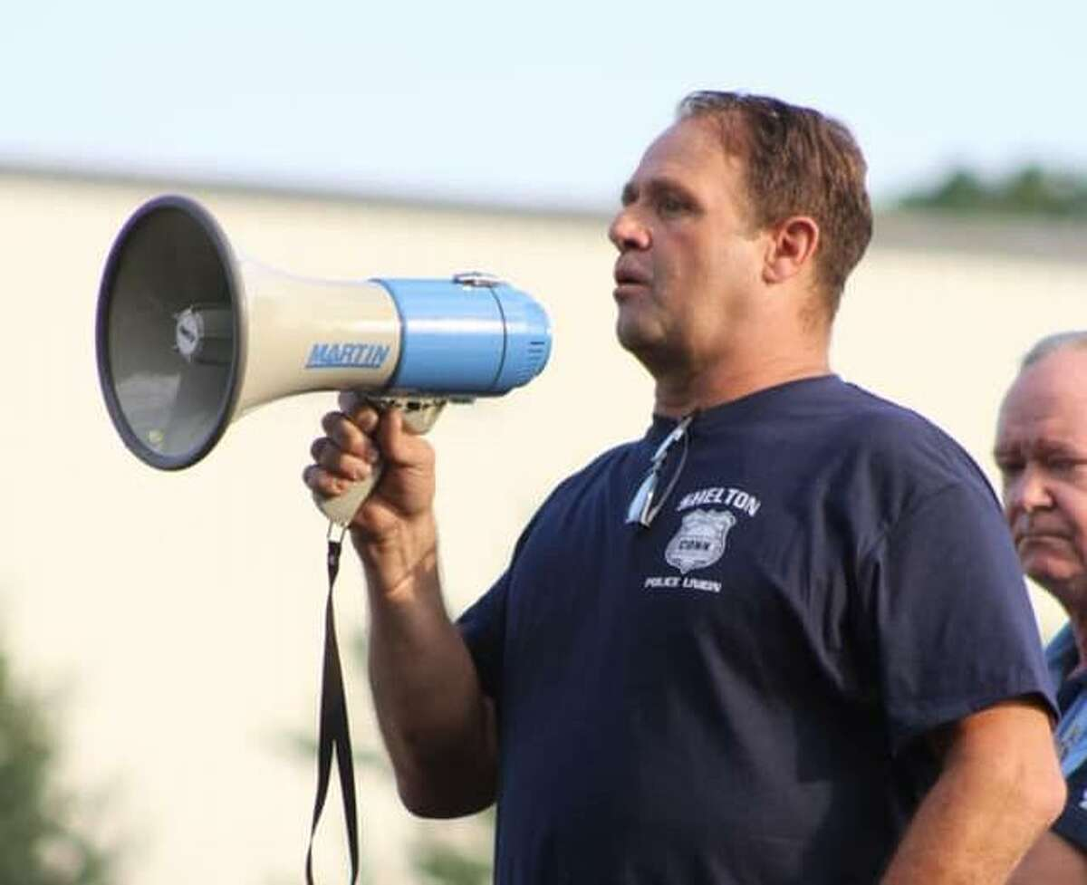 Shelton police officer Dave Eldridge speaks during the rally Thursday, July 2, in support of local rank and file police officers.