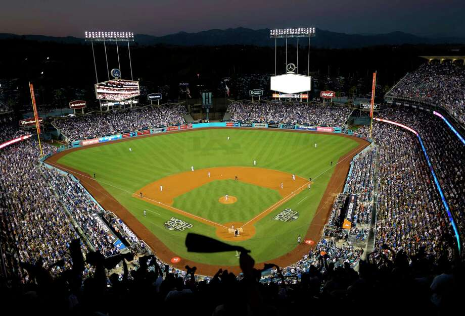FILE - In this Oct. 25, 2017, file photo, the Houston Astros and the Los Angeles Dodgers play in Game 2 of the baseball World Series at Dodger Stadium in Los Angeles. Dodger Stadium's 40-year wait to host the All-Star Game is going to last even longer. The game scheduled for July 14 was canceled Friday, July 3, 2020, because of the coronavirus pandemic, and Dodger Stadium was awarded the 2022 Midsummer Classic. Photo: Tim Donnelly, AP / Copyright 2017 The Associated Press. All rights reserved.
