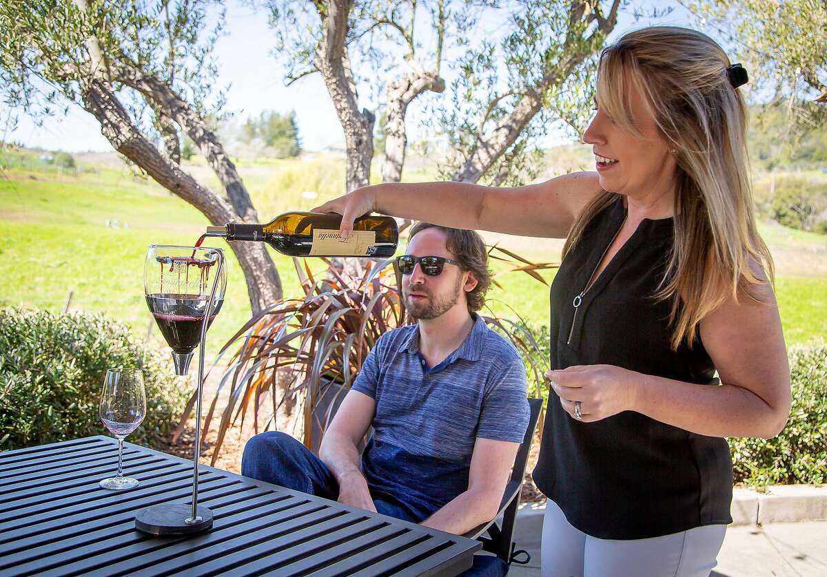 Karen Fontanella pours Cabernet through an aerator for David Kenton at Fontanella Winery in Napa, Calif. on March 16th, 2019.