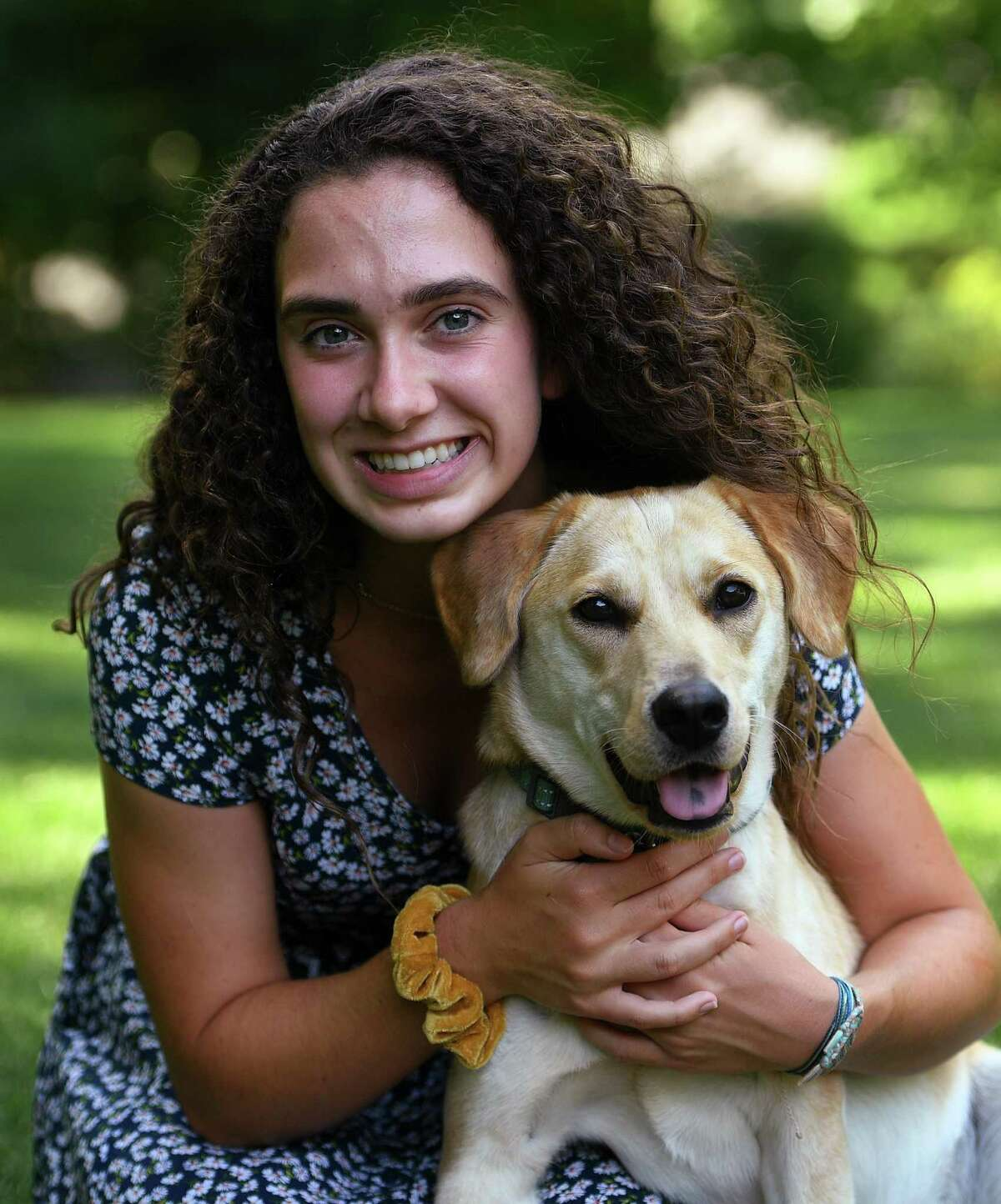 Kevin M. Eidt Memorial Scholarship winner and Norwalk High grad Libby Christinat with her dog, Avery, in Norwalk on Monday.