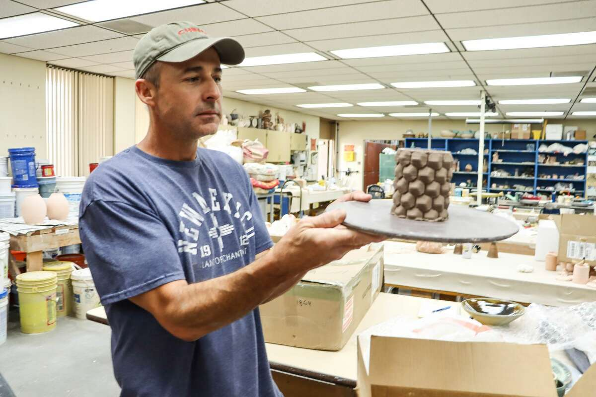Michael Richardson, associate professor of art at Midland College, displays pottery designed and created using new 3D technology.