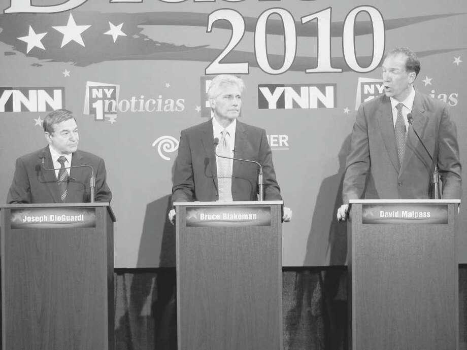 Republican U.S. Senate candidates Joe DioGuardi, Bruce Blakeman and David Malpass debate Tuesday night, Aug. 24, 2010, at Union College in Schenectady. (YNN Pool Photo)