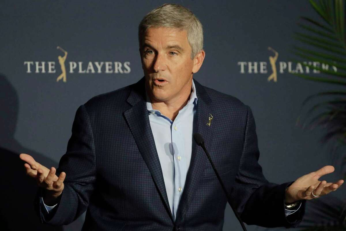 FILE - In this March 13, 2020, file photo, PGA Tour Commissioner Jay Monahan reacts to a question during a news conference at The Players Championship golf tournament, in Ponte Vedra Beach, Fla. Ita€™s been over three months since the commissioners of major sports cancelled or postponed events because of the coronavirus. Enough time for us to grade them on how theya€™ve handled the virus so far. (AP Photo/Chris O'Meara, File)