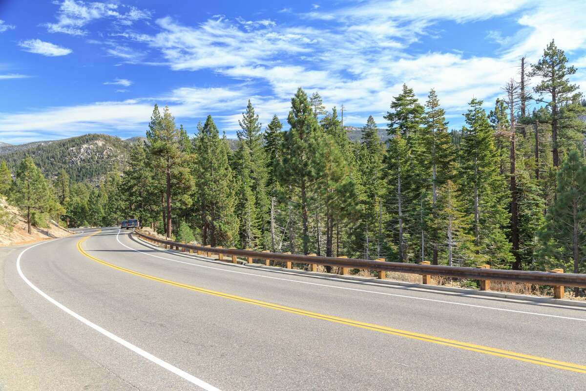 FILE PHOTO: Highway curves through the mountains at Tahoe National Forest, California, USA.