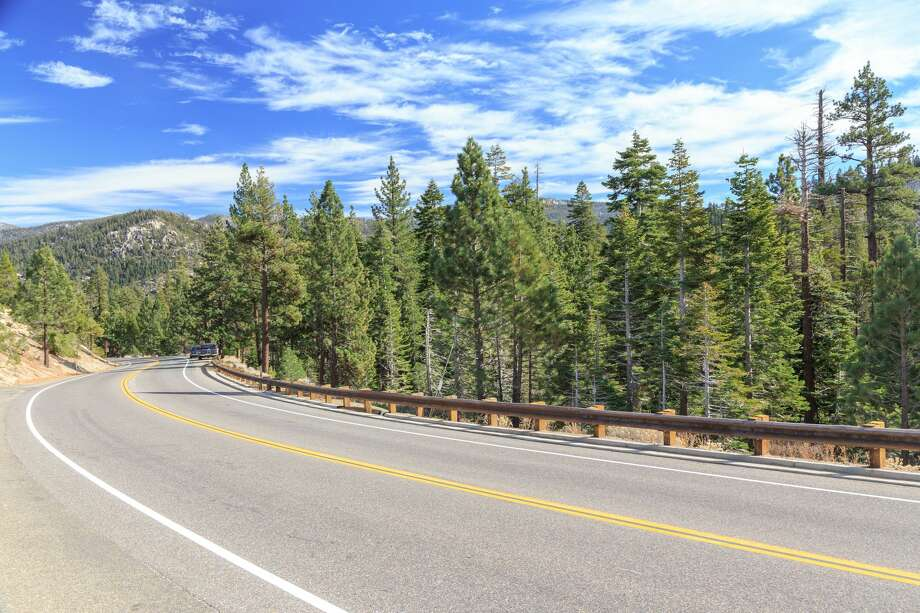 FILE PHOTO: Highway curves through the mountains at Tahoe National Forest, California, USA. Photo: Janniswerner/Getty Images/iStockphoto / janniswerner