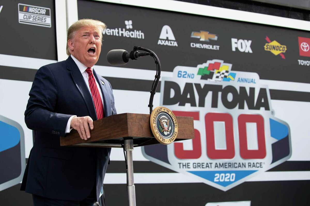 FILE - In this Feb. 16, 2020, file photo, President Donald Trump speaks before the start of the NASCAR Daytona 500 auto race at Daytona International Speedway, Sunday n Daytona Beach, Fla. NASCARa€™s layered relationship with Trump took a sharp turn Monday, July 6, 2020, when Trump blasted the series for banning the Confederate flag and wrongly accused the sporta€™s only full-time Black driver of perpetrating a€œa hoaxa€ when a crew member found a noose in the team garage stall.(AP Photo/Alex Brandon, File)