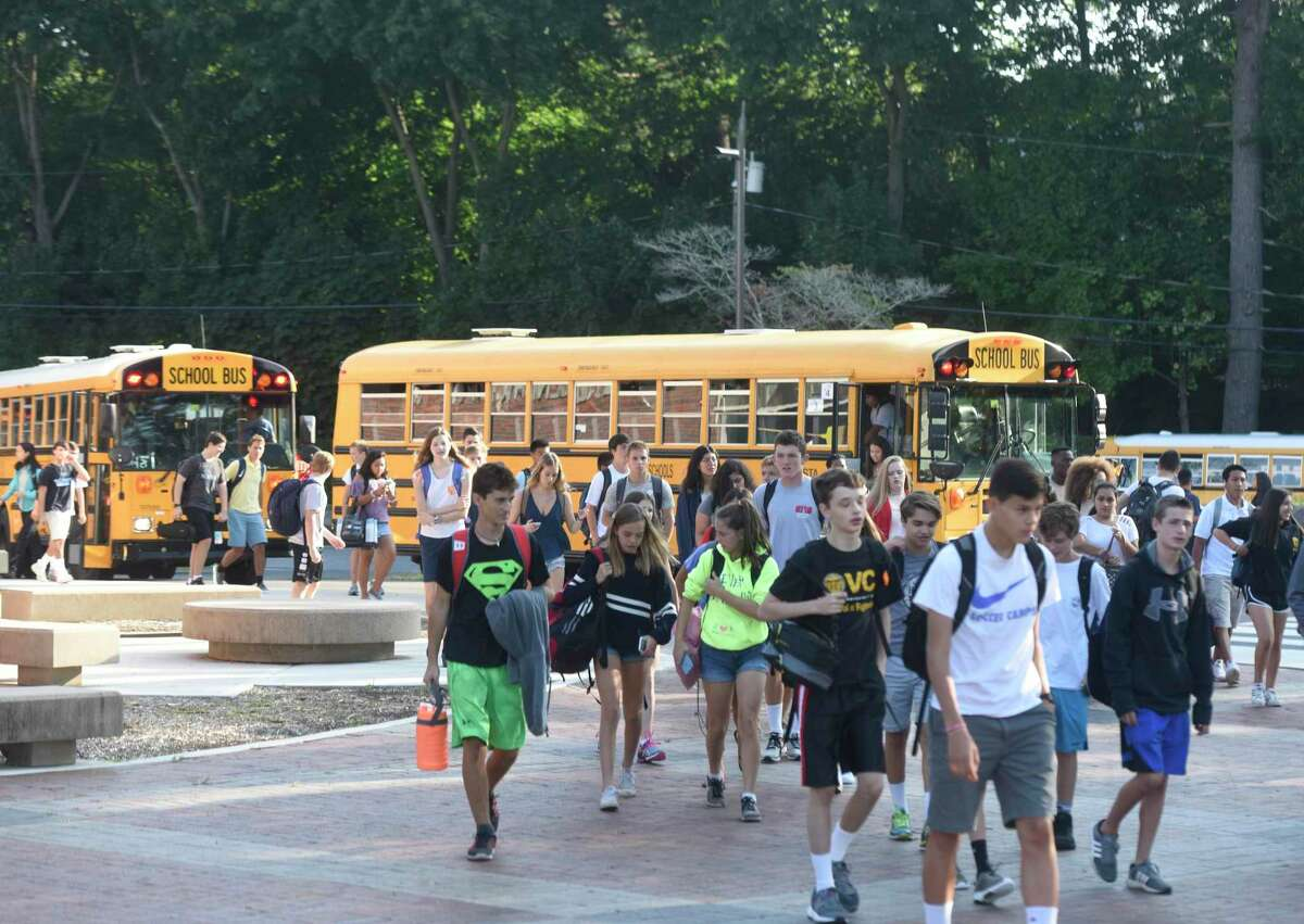 Students walk into school on the first day of the 2017-2018 school year at Greenwich High School in Greenwich, Conn. Thursday, Aug. 31, 2017.