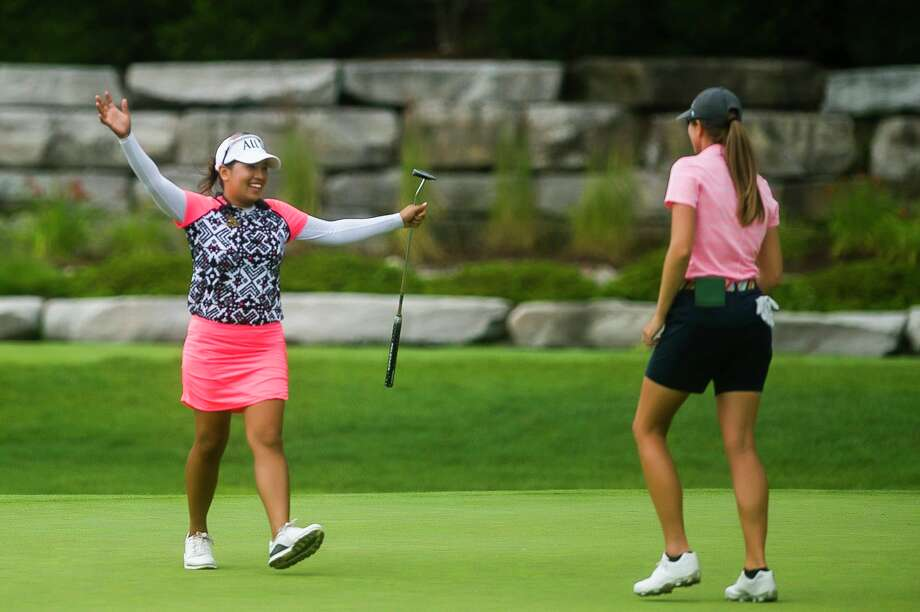 Jasmine Suwannapura, left, walks over to hug her partner, Cydney Clanton, after they won the inaugural Dow Great Lakes Bay Invitational in July 2019 at Midland Country Club. After being canceled in 2020 due to the COVID-19 pandemic, the Dow GLBI is scheduled to be held again this coming July. (Katy Kildee/kkildee@mdn.net)