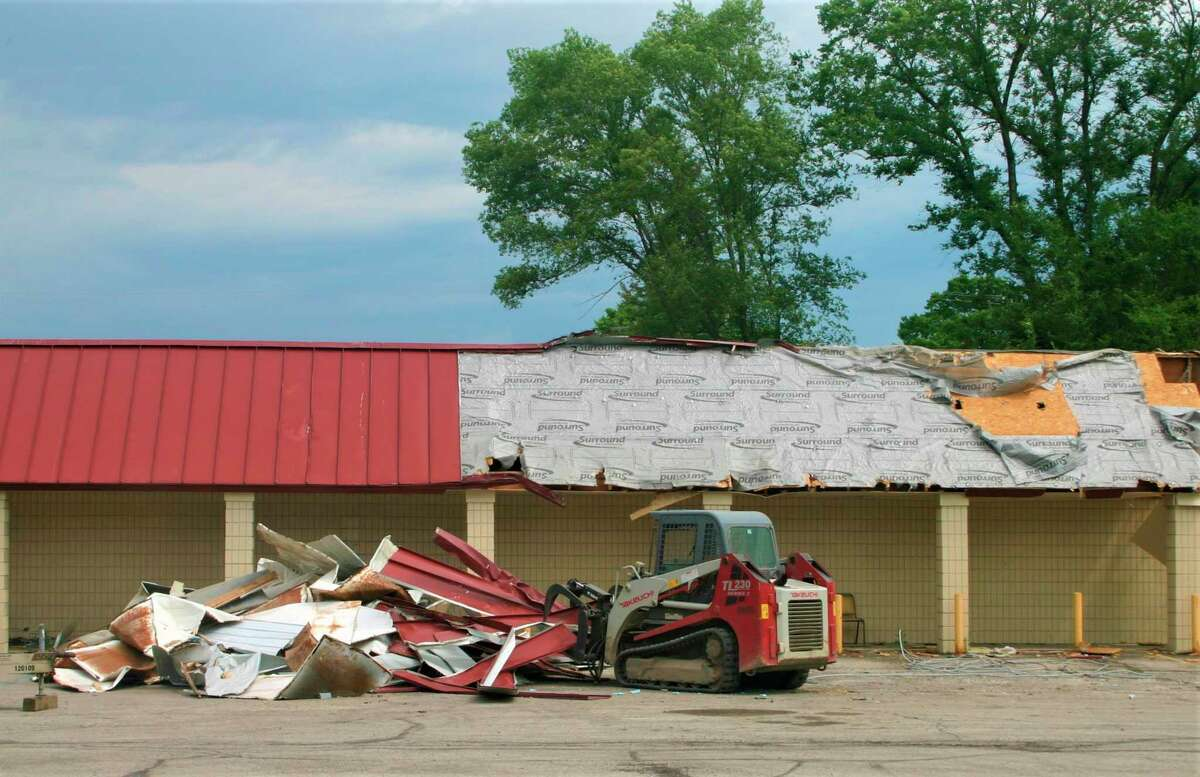 Materials from inside the old Vic's Supermarket are hauled away in preparation for its demolition. Gerber Construction of Reed City began demolishing the old structure this week. The new Ebels Supermarket is expected to open in February 2021. (Herald Review photo/Cathie Crew)