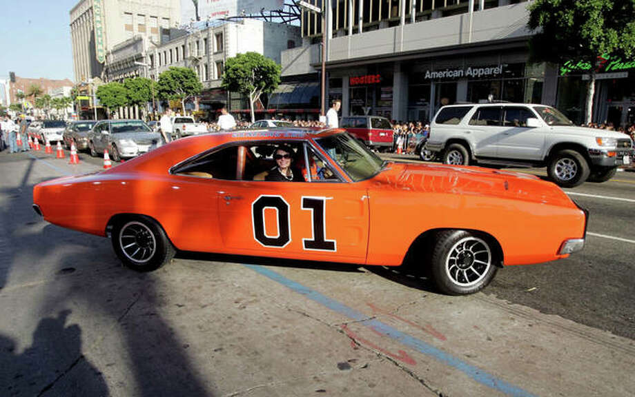 "The General Lee, a 1969 Dodge Charger muscle car, arrives July 28, 2005, at the premiere Of ""The Dukes of Hazzard"" at Grauman's Chinese Theatre in Hollywood, California. Photo: Kevin Winter 